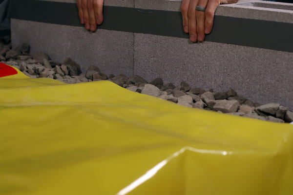 Use-StegoTack-Tape-at-the-Height-of-the-Slab